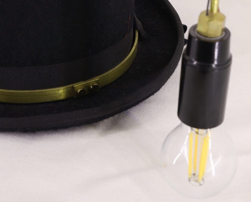 Detail: Lamp and brass hatband